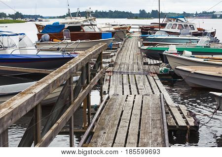 Old Wooden Floating Pier With Moored Boats