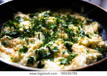 Omelet In Frying Pan With Fresh Parsley