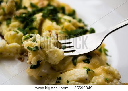 Omelet On A Plate With Fresh Parsley And Fork