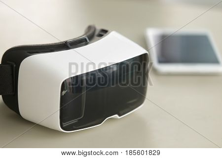 Virtual reality glasses and tablet image. Instruments for augmented reality and 3d visualization. Modern VR electronic devices for work, conversation, gaming and entertainment in digital simulation
