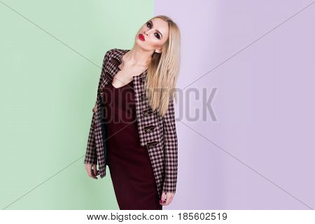 Beautiful Woman With Makeup In Dress And Fashionable Coat