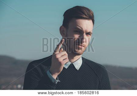 Handsome Man Pointing Index Finger Up