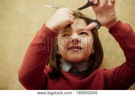 Girl Shutting Eye From Fear While Cutting Hair