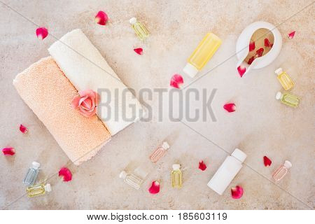 Spa still life with roses  beauty skin care products. Top view, blank space, rustic surface