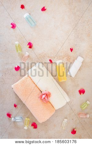 Rose flower and essential oils,  spa and aromatherapy still life.   Top view, rustic surface, blank space