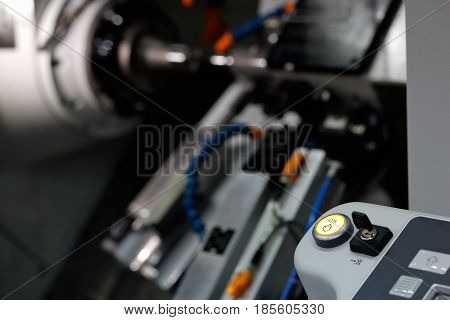 Close up of cnc turning lathe machine. Selective focus on OK push button.