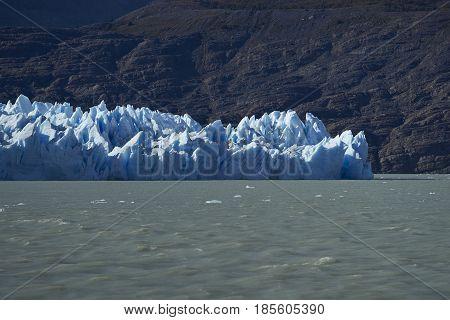 Glacier Grey flowing into Lago Grey in Torres del Paine National Park, Magallanes, Chile