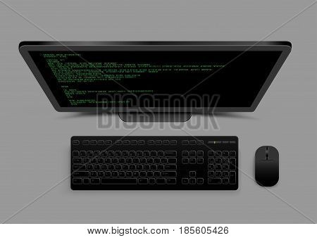 Black modern computer from above with shadow on gray background. Wireless monitor keyboard and mouse. Code on the screen