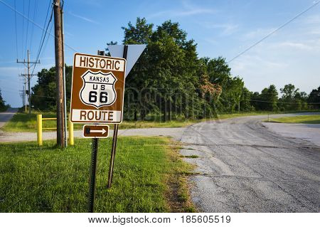 Historic Route 66 road sign in a stretch of the original road in the State of Kansas USA; Concept for travel in the USA and Road Trip