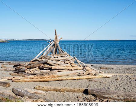Driftwood construction on the sandy ocean beach