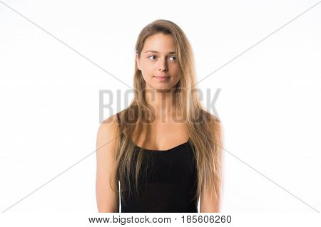 Portrait of doubtful looking beautiful young blonde sport woman.