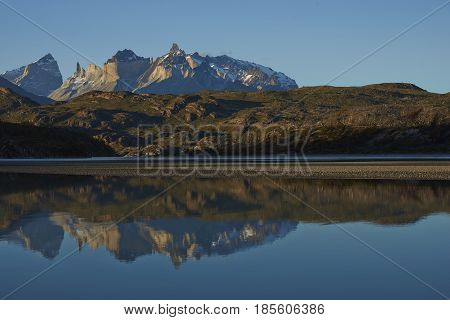 Mountain peaks of Cuernos del Paine rising above the southern end of Lago Grey in Torres del Paine National Park in Patagonia, Chile.
