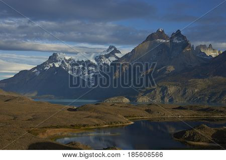 Peaks of Torres del Paine towering over the waters of  Lago Nordenskjold in Torres del Paine National Park in southern Chile
