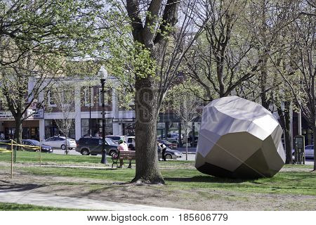 Burlington, Vermont - May 1, 2014 - Wide view of a sculpture on the grounds of City Hall Park in downtown Burlington, Vermont on a sunny day in early May.
