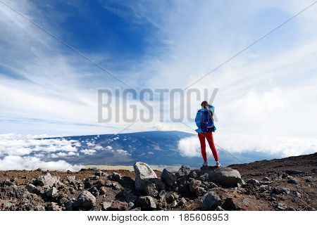 Tourist Admiring Breathtaking View Of Mauna Loa Volcano On The Big Island Of Hawaii, Usa