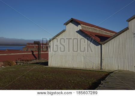 PUERTO NATALES, CHILE - APRIL 15, 2017: Historic buildings of a former meat refrigeration plant that have been renovated and converted into a luxury hotel.