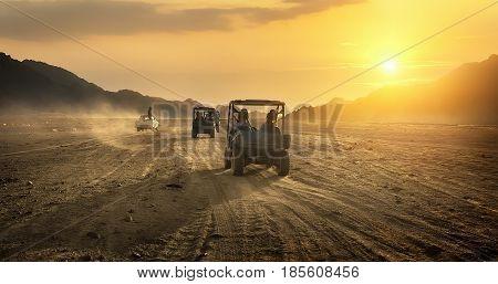 Buggy riding in egyptian desert at sunset, Egypt