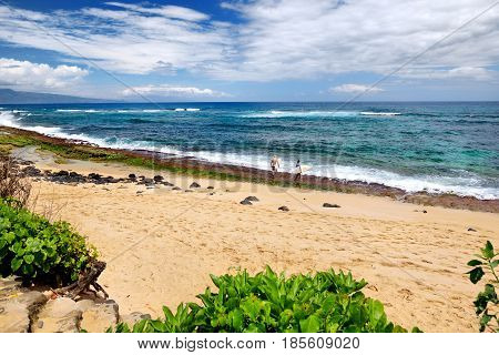 Famous Hookipa Beach, Popular Surfing Spot Filled With A White Sand Beach, Picnic Areas And Pavilion