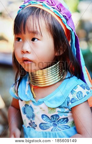 Thailand North Chiang Rai - January 2016: Little girl of the Padaung tribe in a traditional national village.