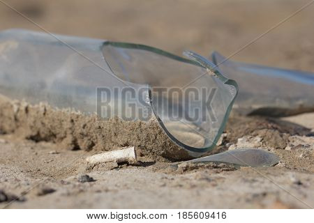 broken glass bottle in the sand . Photo in nature
