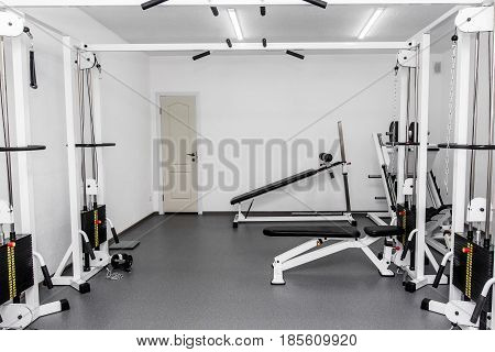 Rehabilitation Equipment In Therapy Clinic. Modern Gym Weight Training Equipment For Exercises And R