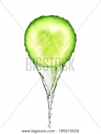 Essence flows as stream from fresh slice of cucumber on white background