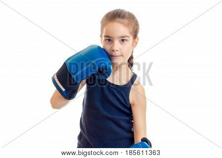 little cute girl in boxing gloves looks at camera isolated on white background