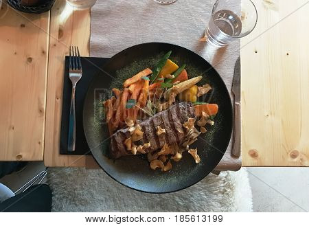 mobile photo top view juicy delicious steak in plate