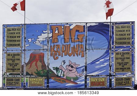 Cornwall, Quebec - July 26, 2014 - Close up of a colorful descriptive billboard sign at the Ribfest in Cornwall, Ontario on a sunny afternoon in July.