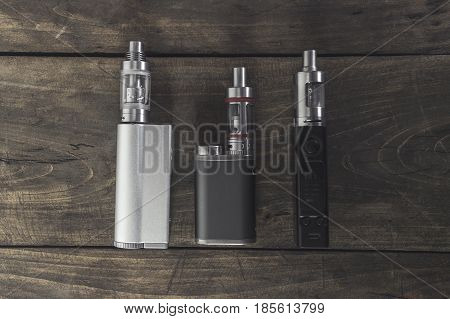 Advanced vaping device e-cigarette on the table. From above