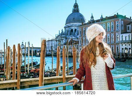 Traveller Woman On Embankment In Venice Having Walking Tour