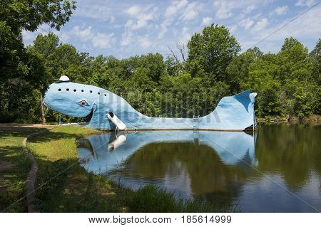 Catoosa Oklahoma - July 7 2014: View of the famous road side attractions Blue Whale of Catoosa along the historic Route 66 in the State of Oklahoma USA.