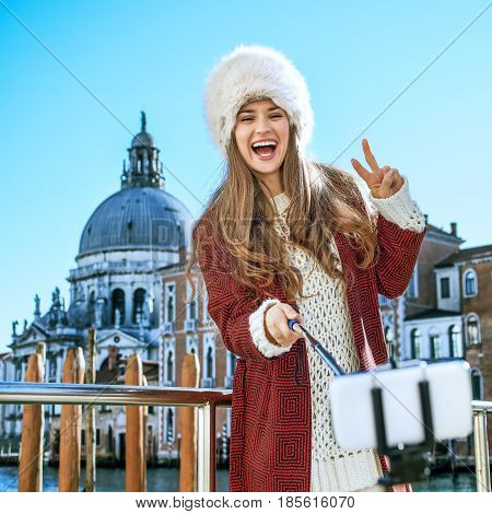 Woman In Venice Taking Selfie And Showing Victory Gesture