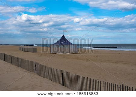 A large tent on an empty beach on a spring morning