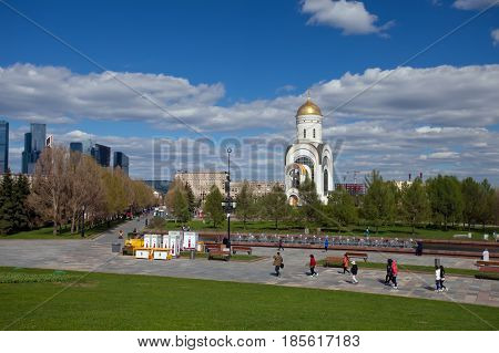 Moscow Russia - May 4 2017: View from the Poklonnaya Hill on Temple of St. George fountain and walking people in Victory Park. Moscow