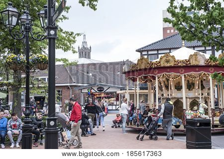 Roermond, Netherlands 07.05.2017. People walking around at the Mc Arthur Glen Designer Outlet shopping center area