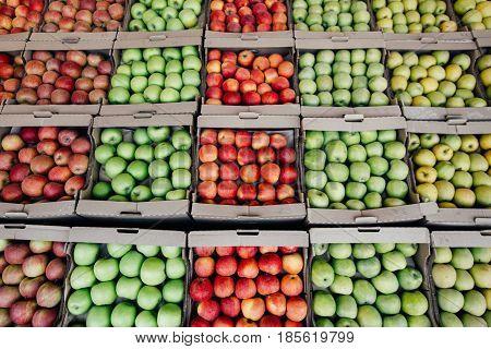 Apples in the supermarket. Apples on market stall. Apple harvest.