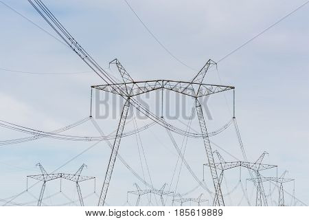 High-voltage Power Lines Against The Blue Sky.
