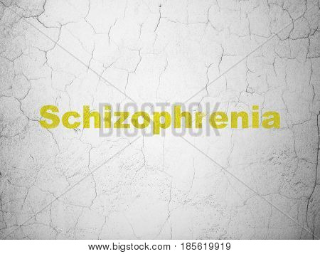 Medicine concept: Yellow Schizophrenia on textured concrete wall background
