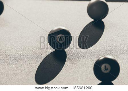 Billiard cue balls on green table. Pool game