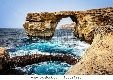 Waves against cliffs at The Azure Window at Dwejra on Gozo island, Malta.