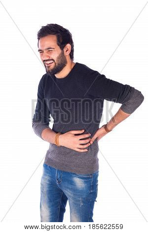 tired beard young man feeling pain and golding his back guy wearing gray t-shirt and jeans isolated on white background