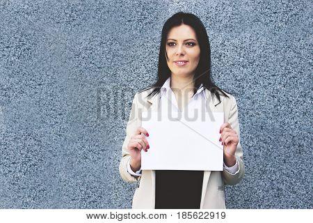 Business Idea. Happy Beautiful Business Woman In Formal Wear Holding Blank Flipchart In Her Hands Wh
