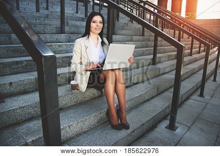 Working Time. Beautiful Young Business Woman In Formal Wear Working On Her Laptop While Sitting Outd