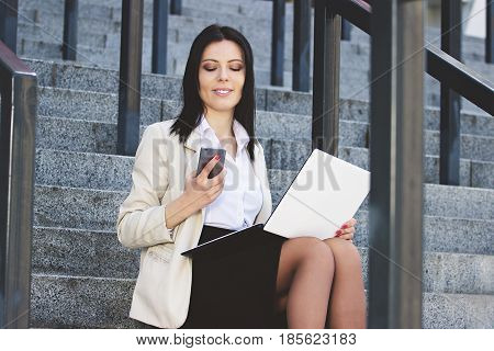 Business Messaging. Portrait Of Beautiful Smiling Business Woman Typing Message On Her Phone While W
