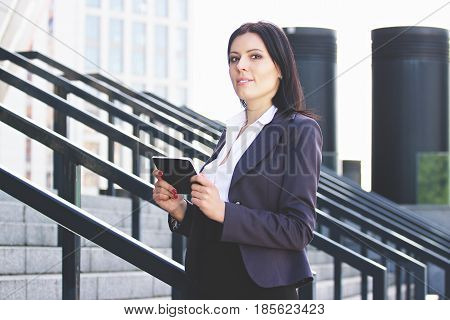 Smart And Beautiful. Serious Young Business Woman In Smart Casual Wear Carrying Digital Tablet And L