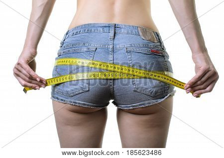 Young Woman Measures The Buttocks With A Measuring Tape, Isolated On White.