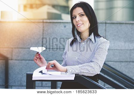 Useless Documents. Happy Attractive Business Woman In Smart Casual Wear Is Making Paper Plane From D