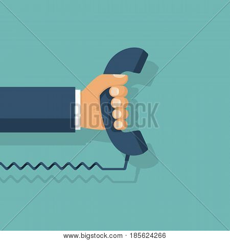 Handset in hand. Holding telephone. Old classic phone. Vector illustration flat design. Isolated on background.