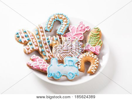Traditional Czech Christmas cookies, Hand decorated with colorful Christmas cookies on white plate, gingerbread pastry, Classic Christmas cookies